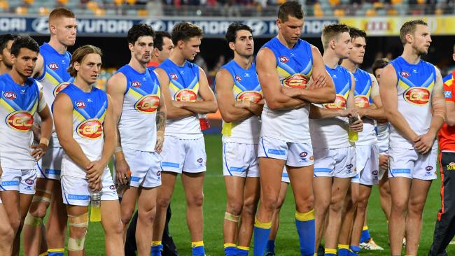 Gold Coast players after the QClash loss to Brisbane.