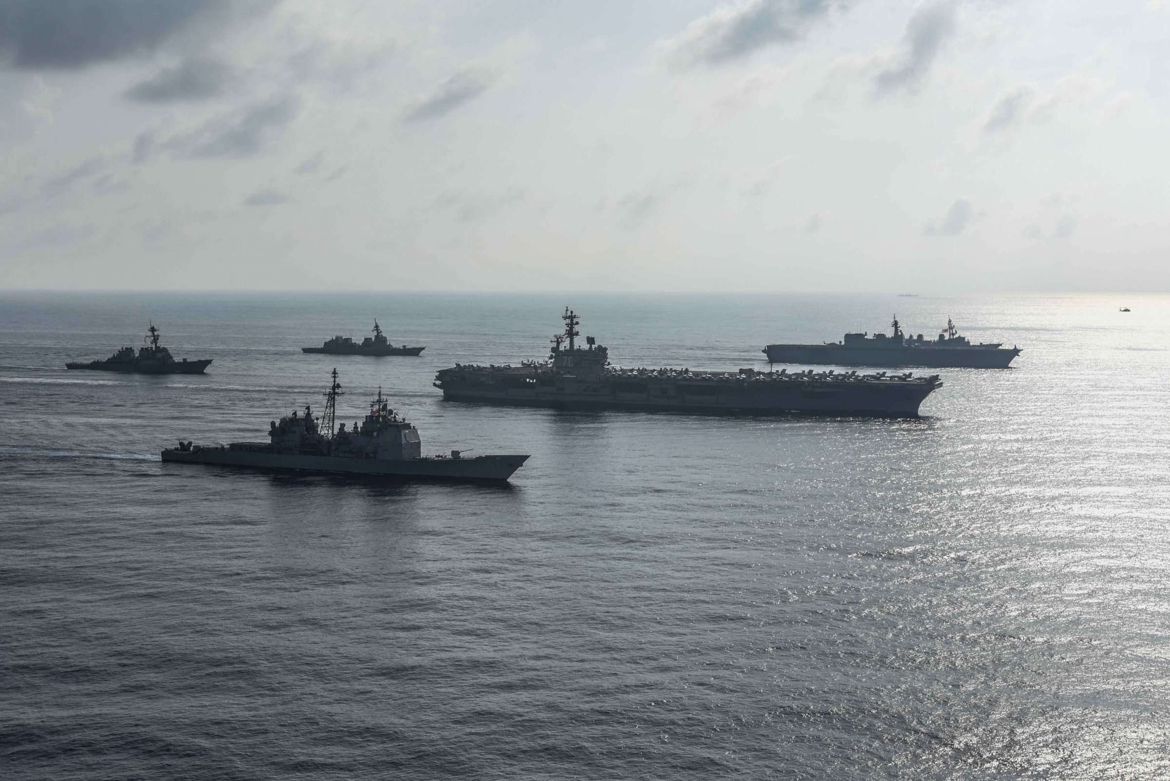 The Ronald Reagan Strike Group ship's aircraft carrier USS Ronald Reagan conduct an exercise with the Japanese Maritime Self-Defense Force ships