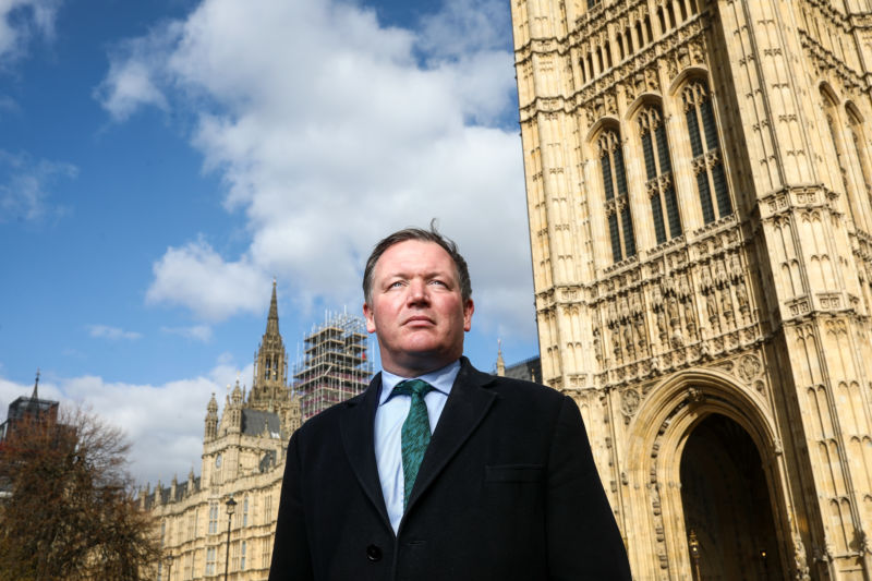 "Damian Collins, chairman of U.K. House of Commons' digital culture and sport committee poses for a photograph outside the Houses of Parliament in London, U.K., on Tuesday, March 20, 2018. Collins asked Facebook Inc. Chief Executive Officer Mark Zuckerberg Tuesday to answer for a ""catastrophic failure of process"" as reports emerged concerning Cambridge Analytica, the U.K. firm at the center of the privacy scandal."