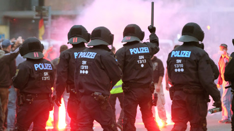 FILE PHOTO. Riot police confront right wing protesters in Chemnitz, Germany on August 27, 2018. © Sebastian Willnow