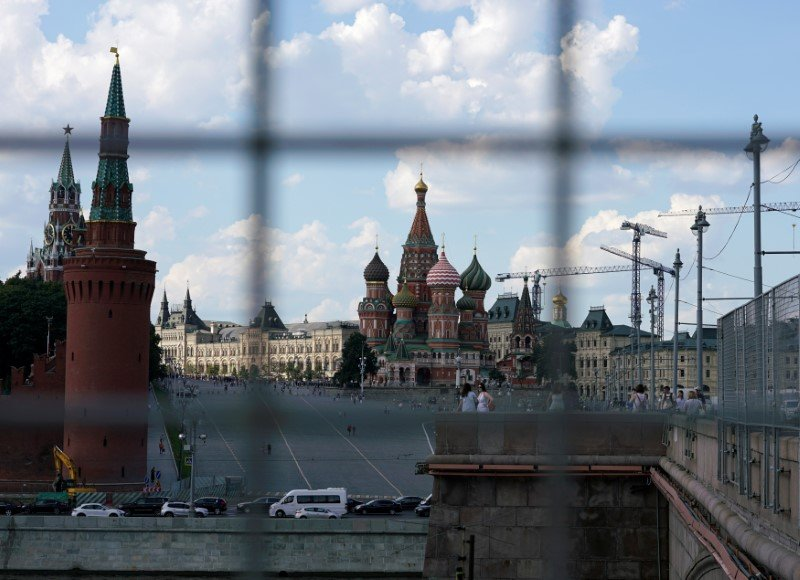 FILE PHOTO - A view through a construction fence shows the Kremlin towers and St. Basil's Cathedral on a hot summer day in central Moscow, Russia, July 1, 2016. REUTERS/Maxim Zmeyev