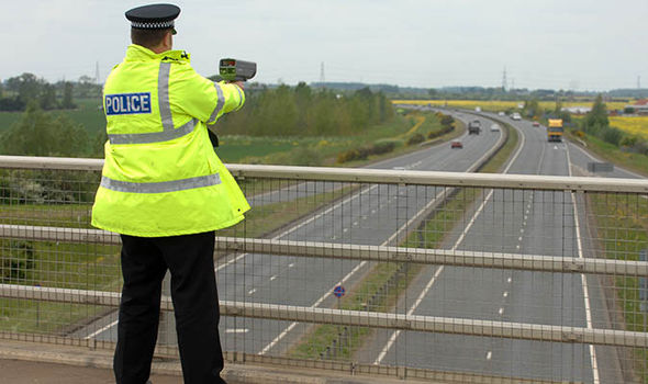 Motorway police officer with speed gun