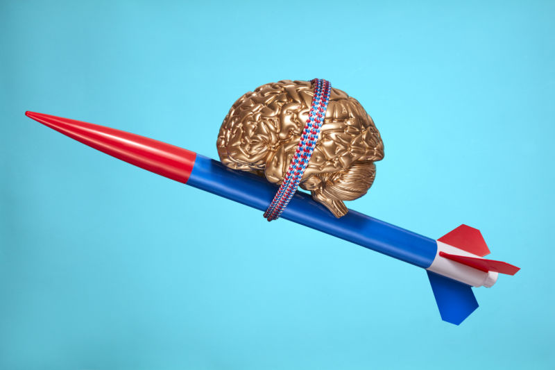 """A model brain atop a rocket symbolizes innovation, progress, and psychology topics."" Thanks, Getty Images!"
