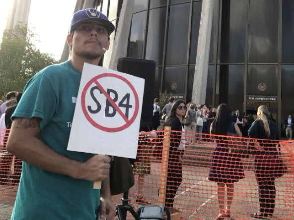 FILE PHOTO: A protester against the Texas state law to punish