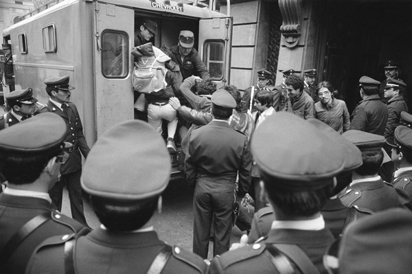 42 17101466 Protestors of the Chilean government under General Pinochet are arrested and hauled off the streets in May of 1983.