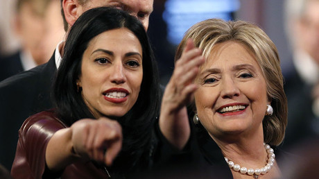 Huma Abedin and former Secretary of State Hillary Clinton. © Jim Young
