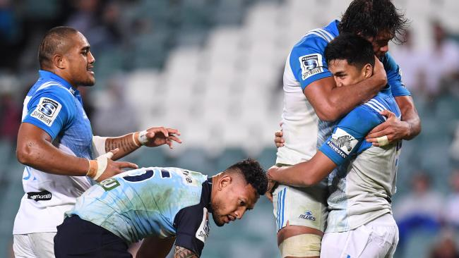 The Blues celebrate Rieko Ioane's try as Israel Folau contemplates another defeat.
