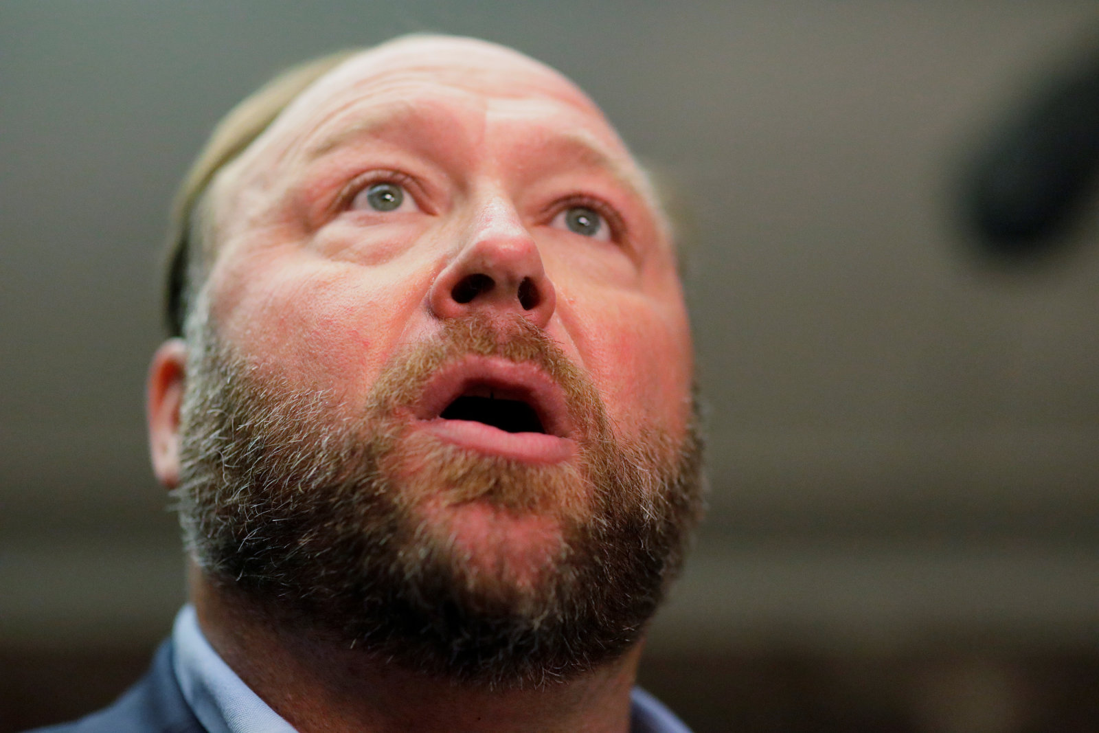 Radio host Alex Jones of Infowars talks to the news media as he arrives to listen to the testimony of Twitter CEO Jack Dorsey and Facebook COO Sheryl Sandberg at a Senate Intelligence Committee hearing on foreign influence operations on social media platforms on Capitol Hill in Washington, U.S., September 5, 2018. REUTERS/Jim Bourg
