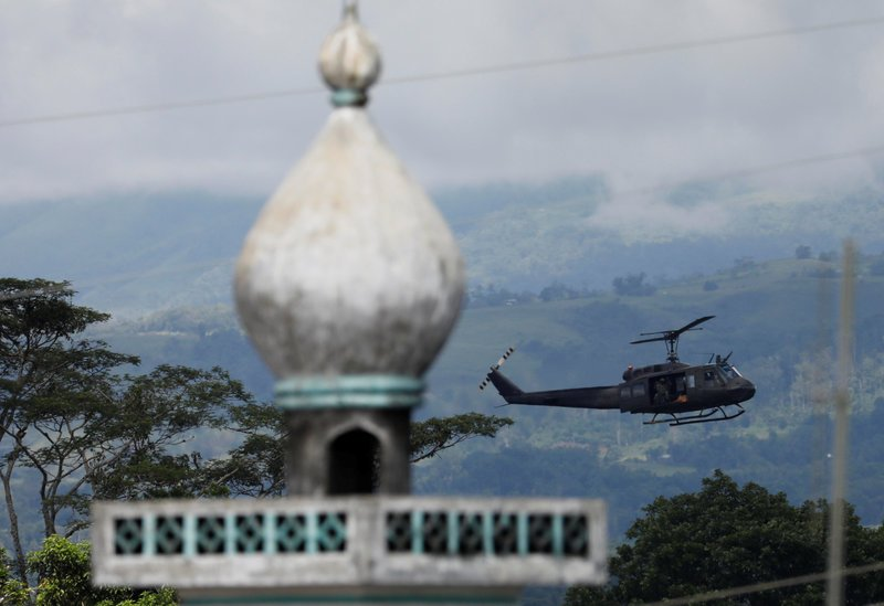 A military helicopter flies past a mosque in Marawi City in southern Philippines May 28, 2017. REUTERS/Erik De Castro