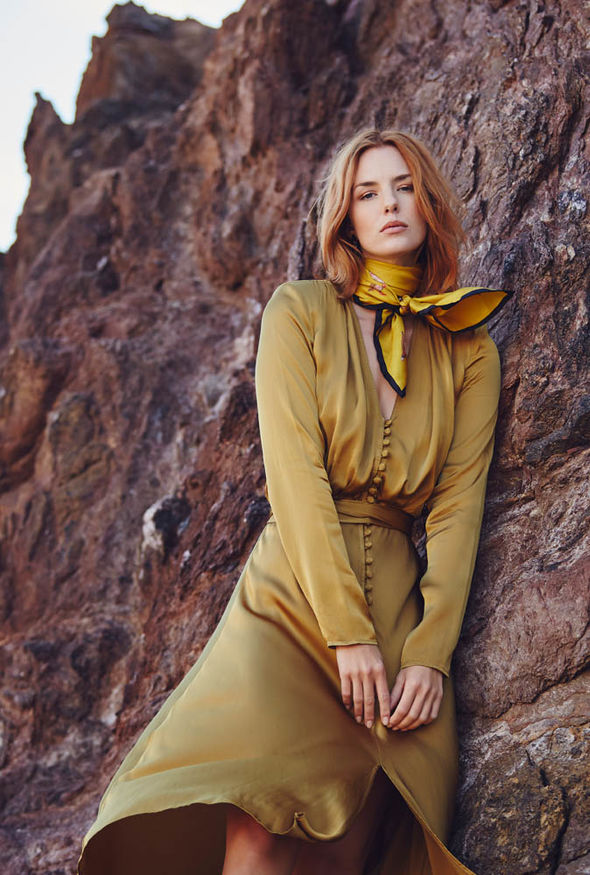 Model wears khaki silk dress