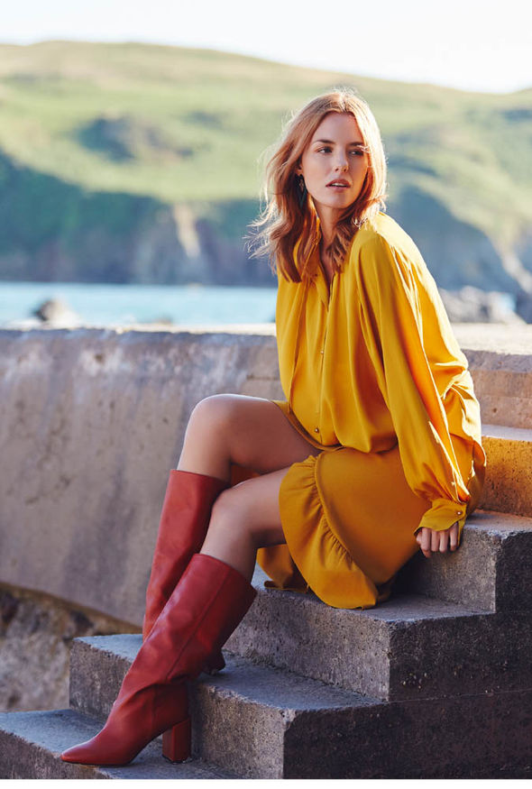 Model wears mustard skirt and top